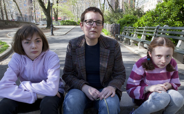 Susan Angel and her daughters Anny (L) and Imogen, who were placed in foster care during a family dispute.