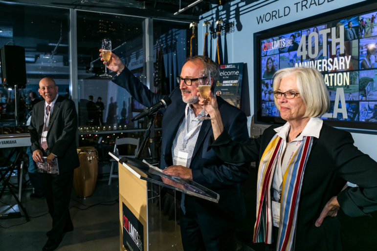 Gala co-chairs Andy Breslau and Elizabeth Cooke Levy toast the honorees and City Limits' four decades of work.