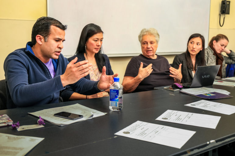 Members of the Community Board 3 Land Use Committee discuss the Chinatown rezoning.
