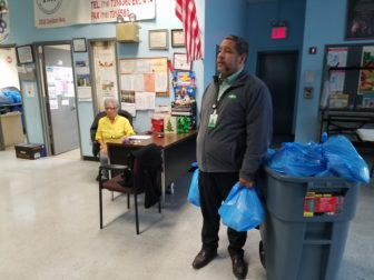 Steven Santana, a volunteer at the food pantry operated by the Davidson Community Center in University Heights.