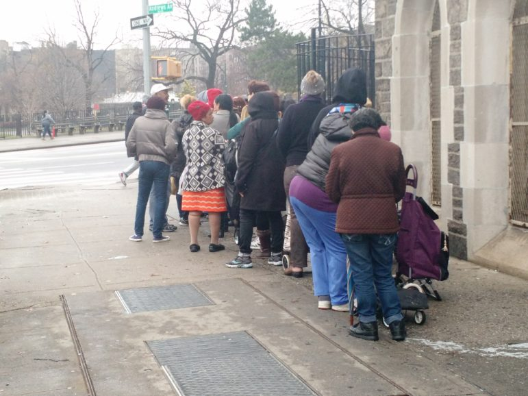 Food pantry guests outside of Saint Nicholas of Tolentine Church in University Heights.