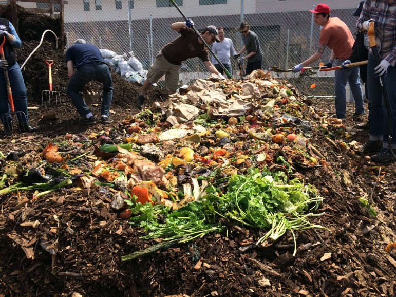 Members of the Gowanus Canal Conservancy work on a windrow during their monthly compost build. Their site is one of more than 200 around the city already involved in reusing food waste that otherwise would be trucked to a landfill.