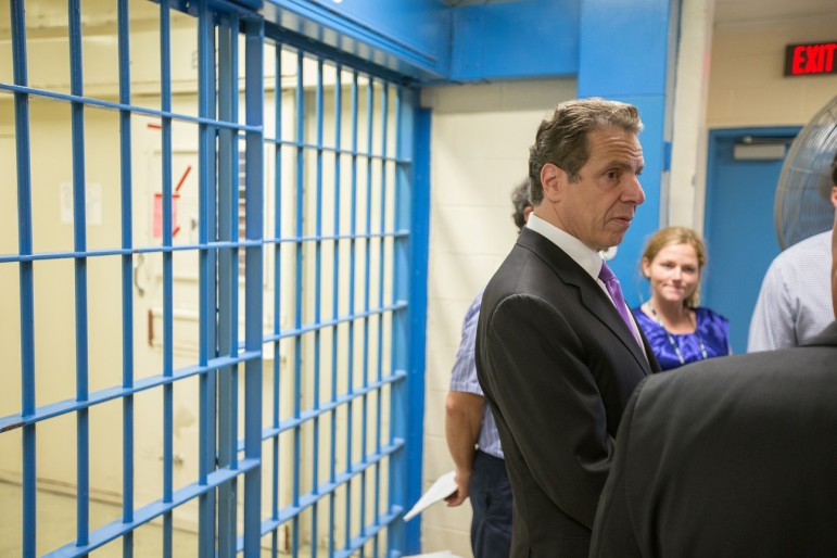 Gov. Cuomo on a recent prison tour. He supports raising the age.