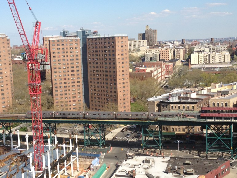 Columbia's new campus rises in the foreground. The Manhattanville Houses are just beyond the elevated 1 train.