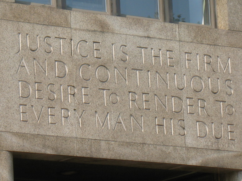 The facade of the criminal court building in Manhattan. Rikers is in many ways an extension of an overburdened, slow-moving court system.