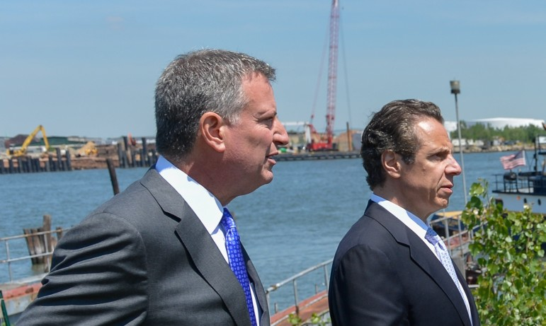 The mayor and governor seen at a 2014 event. De Blasio has offered to go solo on supportive housing, but advocates say the state's help is needed if the program is to achieve the necessary scale.