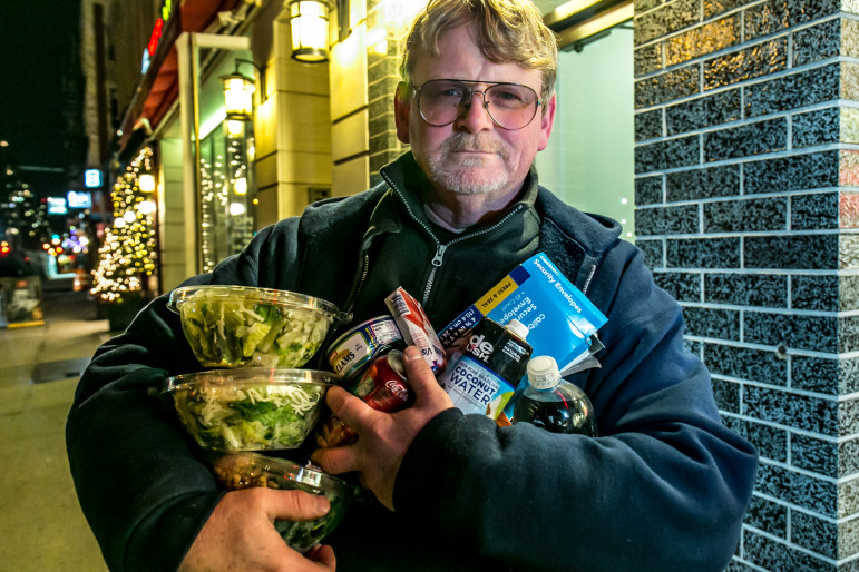 A freegan who goes by the name of 'Smiley' at the end of more than three hours of dumpster diving that spanned from 51st to 86th Street and Park to 1st Avenue.