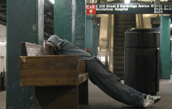 Asleep in the 205th Street-Norwood station. Not an ideal place for a snooze, but probably not a spot that would have been chosen by anyone with better options.