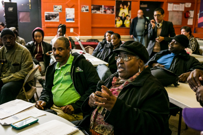 Lolita Miller, treasurer of the Tenants Association at Ocean Bay, asks a question at Tuesday's meeting on the RAD program soon to be implemented there.