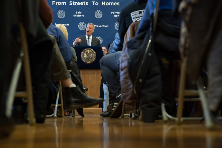 Mayor de Blasio announces his plan to restructure homeless services at a press conference in the Bronx on Monday, April 11.