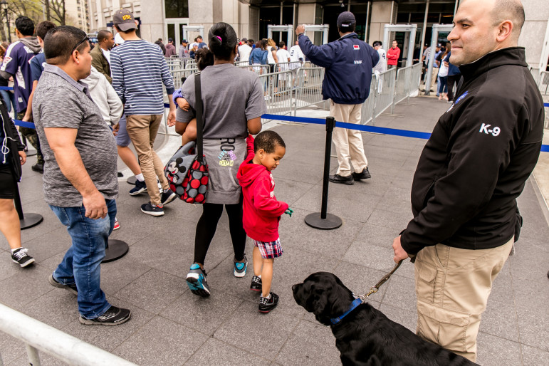 A private security officer outside Yankee Stadium. State regulations and enforcement have failed to track the steady growth of the private-security industry since September 11.