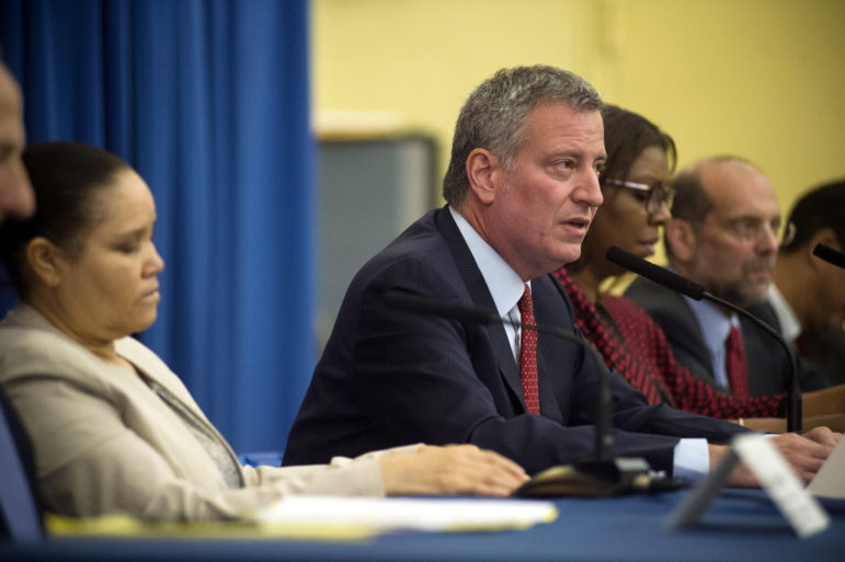 Mayor de Blasio, with Public Advocate Letitia James on his right and tenant Miguelanea Rincon on his left, announcing the new initiative.