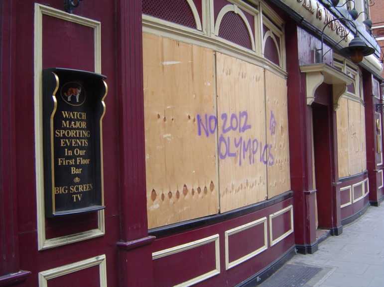 Most but not all New Yorkers wanted the Games. Support for London's bid was not unanimous, either, as the graffiti on this pub indicated.