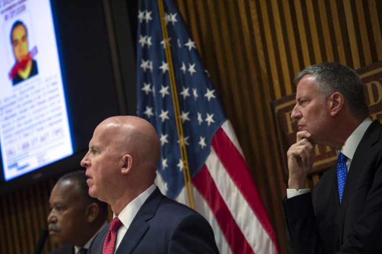 Surveillance cameras caught Commissioner James O'Neill and Mayor Bill de Blasio looking in the same direction.