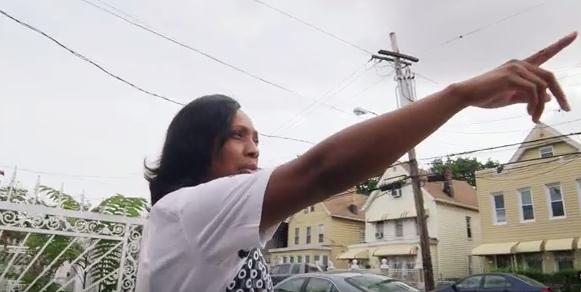 Ramarley Graham's mother, Constance Malcolm, points out where her son was walking before police, coming from a different direction, stormed her house and killed him.
