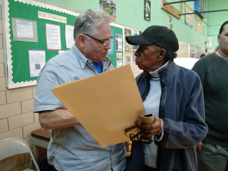 Voters approached Humphrey Ortiz, 63, the polling place coordinator at P.S. 8 Isaac Varian with a constant stream of questions about their ballots, including how to vote for their candidates, how to change their name on their voter registration, how to scan their ballots and more.