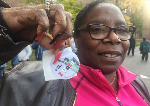 Michelle Ortiz, 51, is a probation officer, waited nearly two hours to vote for Hillary Clinton in Parkchester.