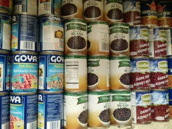Stacked shelves at the food pantry run by Saint Nicholas of Tolentine Church in University Heights.