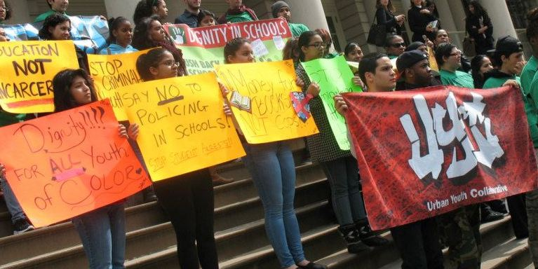 Members of the Urban Youth Collaborative demonstrate at City Hall for a more restorative approach to school discipline.