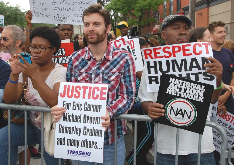 Protesters denounce the deaths of Eric Garner and Michael Brown at a Staten Island protest last summer.