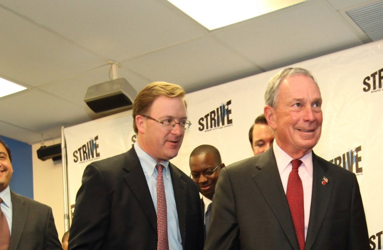 Then-HRA Commissioner Robert Doar at left with Mayor Bloomberg in 2012.