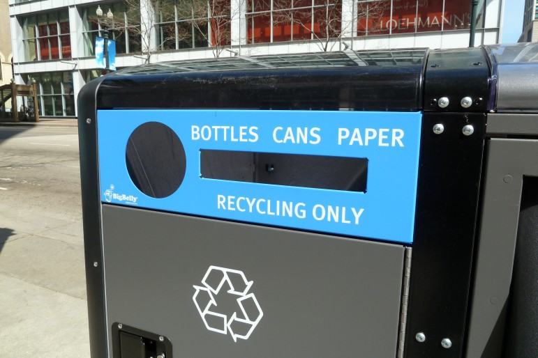 A single-stream recycling container in downtown Chicago. Eliminating the separation of paper from other recyclables tends to boost participation rates but can alter the economics of recycling.