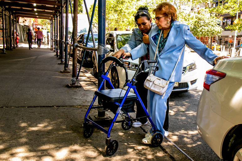 A senior citizen and a caregiver on their way to a senior center run by University Settlement on Allen Street in Manhattan. By 2030, one in five New Yorkers will be older than 60.
