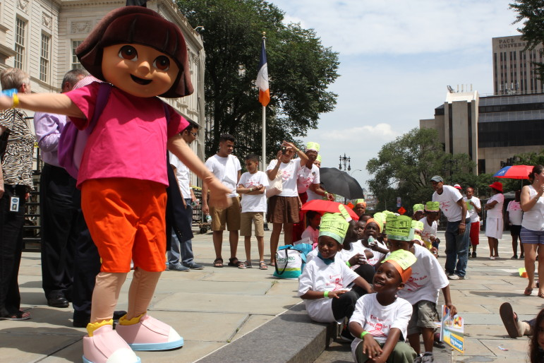 Literacy, Inc. recently gathered children from around the city (and a famous explorer) for a reading rally at City Hall. It and other like-minded groups have struggled to deal with the summer literacy problem.