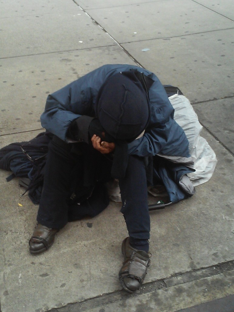 A homeless woman on 34th Street. Stereotypes about homelessness confuse the discussion about the extent of the problem.