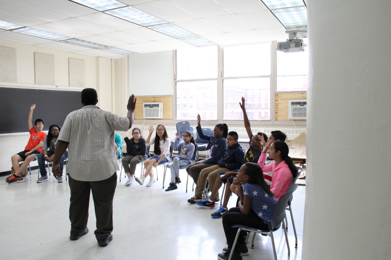 Middle-school students enrolled in the Science of Smart Cities summer program at the NYU Polytechnic School of Engineering participate in a drama workshop run by the Irondale Ensemble Company.