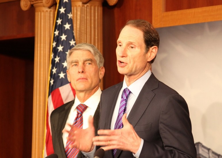 Oregon Sen. Ron Wyden (seen with then-Senator Marc Udall of Colorado at an unrelated press conference) has proposed allowing states to spend more child-welfare money on preventive services.