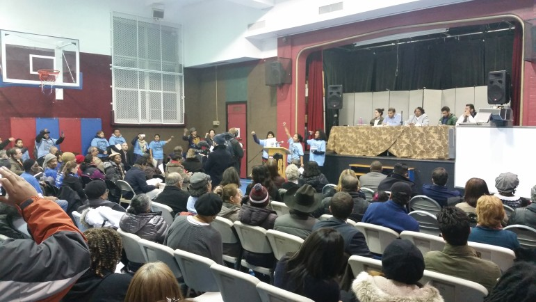 Members of Movement for Justice in El Barrio speak against the mayor's proposals at the CB11 meeting.