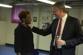 Current NYCHA chairwoman Shola Olatoye and Mayor de Blasio. She's been credited with doing more to engage residents in her own infill proposal, but resistance remains.