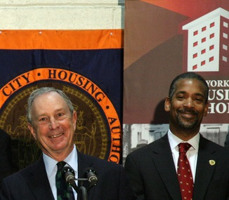 Mayor Bloomberg and John Rhea at a press conference in 2010. Rhea took the heat for maintenance problems and other woes at NYCHA.