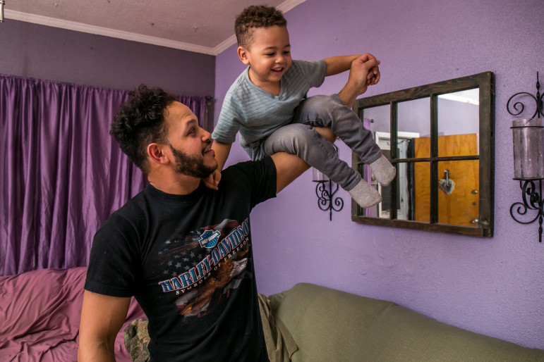Alex Lora with his 3-year-old son, Alexander Lora III, at their residence in Queens, New York. Thanks to a city program that provided a lawyer for him, the elder Lora's immigration case set a new legal standard for others detained in the northeast.