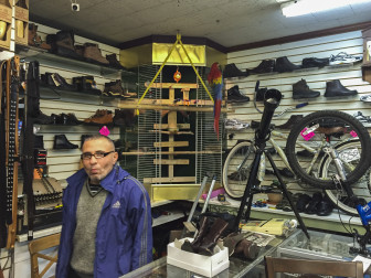 Michael Akhunov at his shoe repair shop in Ridgewood, Queens.