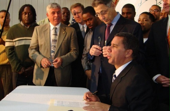 Gov. David Paterson signs the Green Jobs/Green New York Act in the fall of 2009.