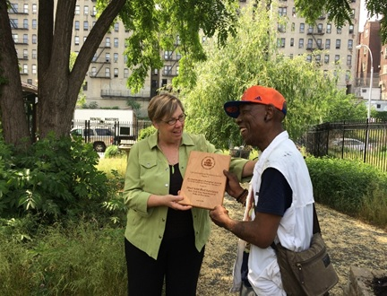 EPA regional administrator Judith Enck presenting a 2015 award to Troy Lancaster, founder of the Dred Scott Bird Sanctuary.