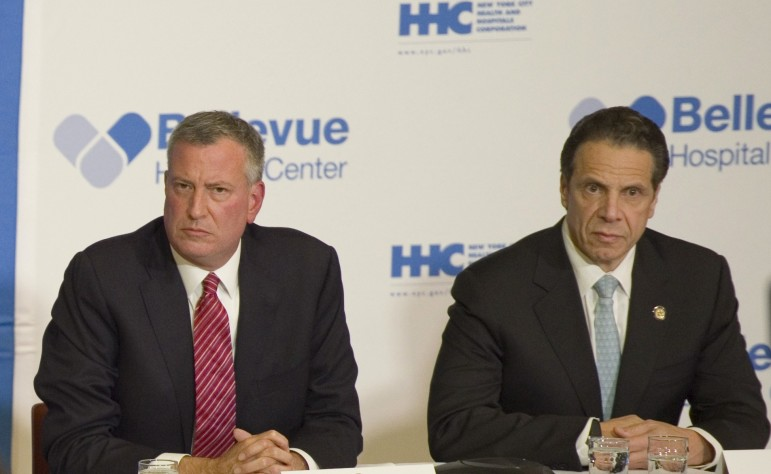 The mayor and governor, seen at a 2014 press conference. Cuomo has faulted de Blasio for his handling of the homeless crisis, but  the story behind the rising shelter numbers is not one of a botched policy.