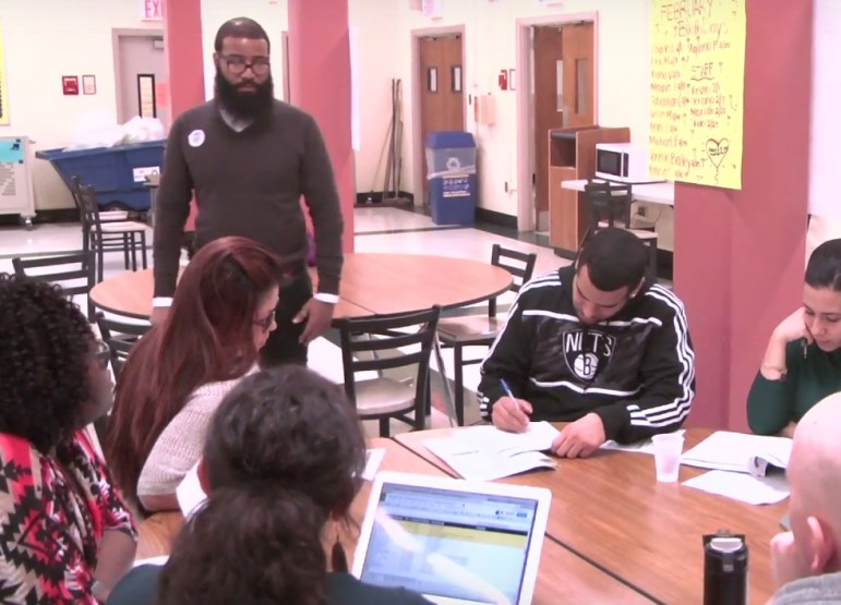 Teachers meet daily at West Brooklyn to discuss each student's progress.