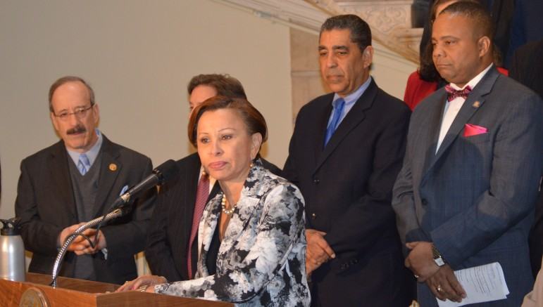Congresswoman Nydia Velazquez, with Rep. Eliot Engel at left and State Senators Adriano Espaillat and Jesse Hamilton at right.