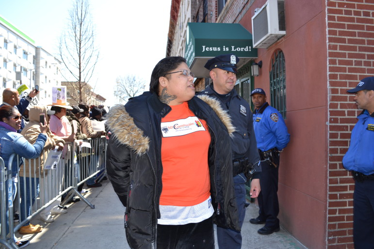 Local advocate Rachel Rivera gets arrested outside Councilman Espinal's offices on Wednesday.