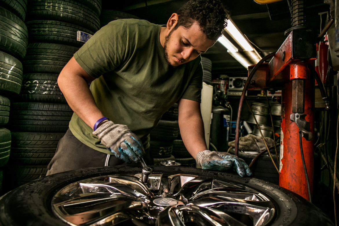 Melvin  has been working at his friend's tire repair shop for the last eight years, starting at age 13.