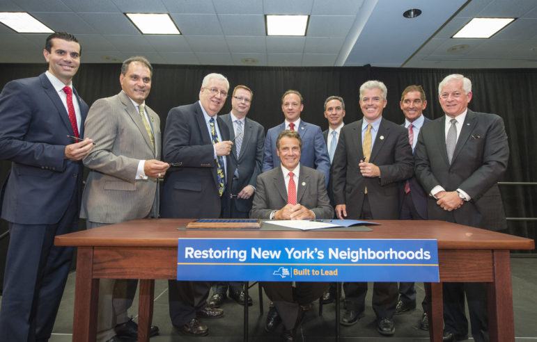 The governor seen earlier this week signing a bill to address so-called 'zombie properties.' Other housing matters, including most of his $1.9B housing plan, went unaddressed this session.