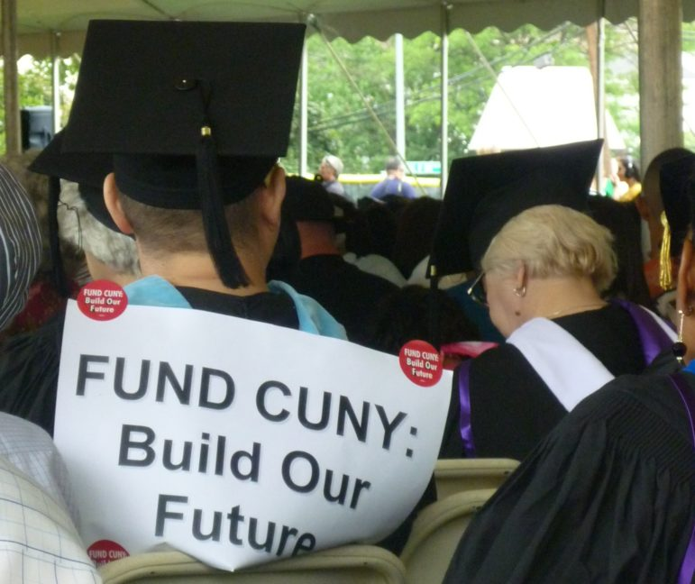The concerns about CUNY's funding are not new. This graduate wore his worries at the Bronx Community College commencement in 2010.