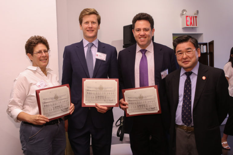 New FCCA board members Barbara Garii, Ph.D., Simon Gerson, Raymond Jasen, and New York City Council Member Peter Koo.