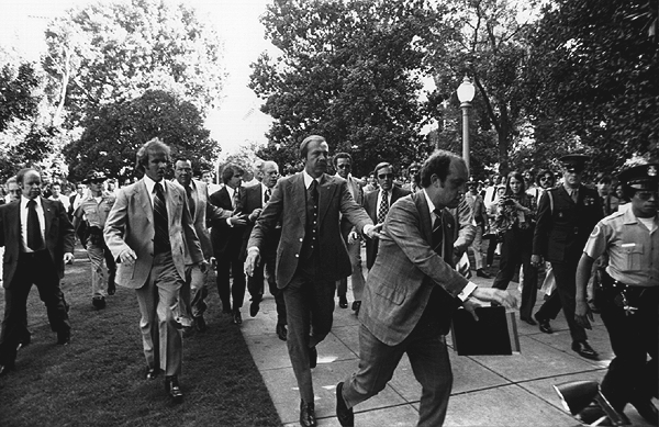 President Ford is rushed from the scene of one of two assassination attempts against him in 1975.