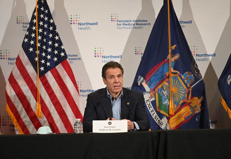 Cuomo and flags